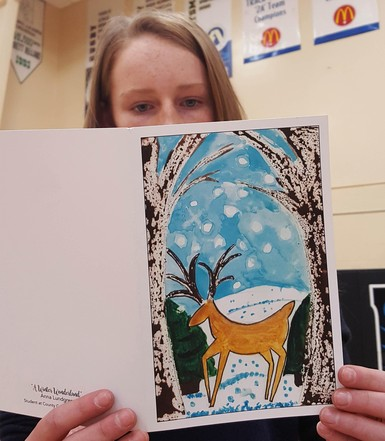 Grade 8 student Anna Lundgren looks over Paliser Regional Schools' greeting card, which features her artwork.