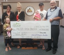 From left to right, Shawna and her daughter Paisley, Spring Merrill, Les and daughter Brightyn, and Palliser's Secretary-Treasurer, Wayne Braun.
