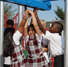 Heritage Christian Academy students enjoy the new playground equipment on the first day of school.
