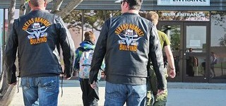 Members of Bikers Against Bullying escort a student to class at Heritage Christian Academy.