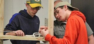 Casson Stroeve of Picture Butte High School, left, and Curtis Penner of Coalhurst High School, get some instruction in the Trades Sampler at Lethbridge College as part of Experiential Learning Week.