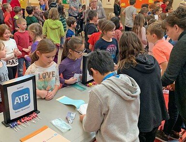 The grand opening of the Vulcan Prairieview Elementary School Junior ATB Branch saw bank staff deal with plenty of customers.