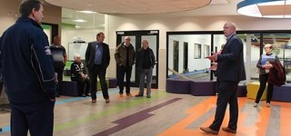 Principal Wayne Funk shows representatives from Palliser Regional Schools and the Town of Coaldale around George Freeman School in Strathmore, a school for elementary and middle school students which is attached to a recreation centre.