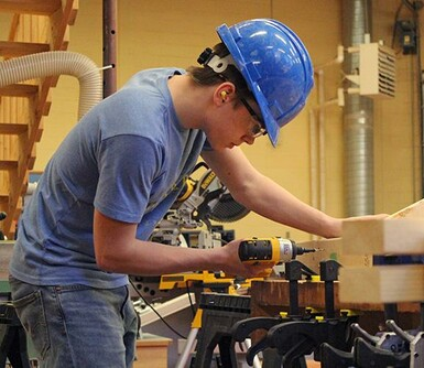 Ajay Coutts of Kate Andrews High School competes in the carpentry event at the regional Skills competition.