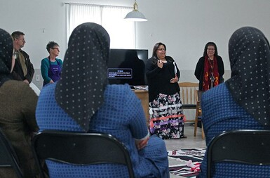 Knowledge Keeper Sarena Provost, and her mother Yvonne at right, explain the premise behind the Blanket Exercise to Albion Ridge Hutterite Colony School students.
