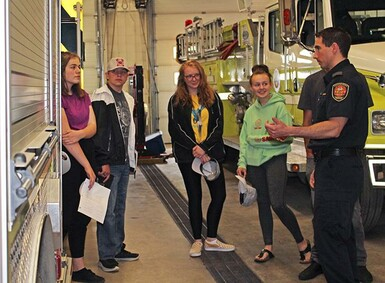 Coaldale Fire Chief Kevin McKeown shows students around the fire hall as part of an orientation for the Kate Andrews Fire Academy program.