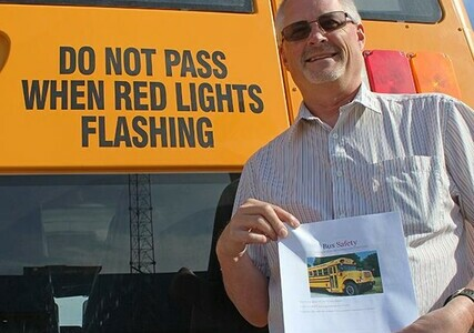Dave Shaw, Palliser's Transportation Services Supervisor, with a copy of the STAA Bus Safety Course lesson plan.