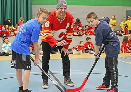 Former Calgary Flame Matt Stajan performs the ceremonial puck drop to kick off Calgary Christian School's annual floor hockey tournament.