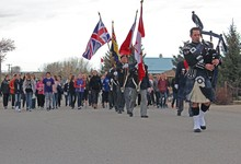 Piper Ryan Calvank leads the colour party and students from Coalhurst High School and Coalhurst Elementary School to the community Cenotaph as part of the 100th anniversary commemoration of the Battle of Vimy Ridge.