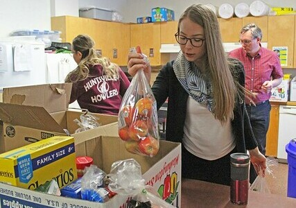 Huntsville School staff pack wellness hampers for delivery to students and their families