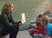 Dayna Anwender gets expressive while sharing a book with students in Palliser Regional Schools' Summer Reading Club at Jennie Emery Elementary School.