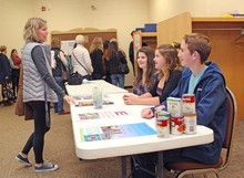 Champion School students accepting donations at the Palliser Regional Schools professional development Summit at Country Central High School in Vulcan.