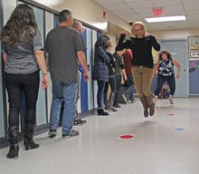 "Palliser staff take part in the ""Don't Walk in the Hallways"" by Ever Active Schools as part of the professional development Summit."