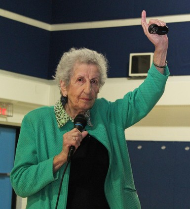 Holocaust survivor Eva Olsson asks those who have been bullied to raise their hands during a presentation at Kate Andrews High School in Coaldale.