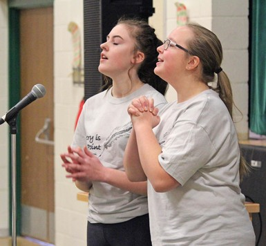 Students Kennedi O'Brien, left, and Abbey Dorchak delivered their poem with passion to win the group category at Noble Central School's Poetry Slam.