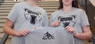 Amara Klassen, left, and Caitlin Sparrow, both member of R.I. Baker Middle School's Student Leadership Council, show off the shirts they are selling for the Michael Project.