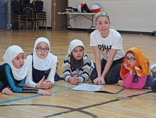 Right to Play facilitator Meghan Mutrie works with students at Calgary Islamic School OBK Campus on the Play Your Part program.