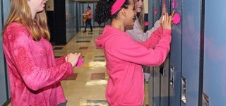 Students put compliments on sticky notes up around the Menno Simons Christian School as part of Pink Shirt Day.
