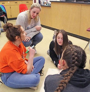 Workshop facilitator Shelby Dorfman works with students to come up with an action plan for an awareness/fundraising project.