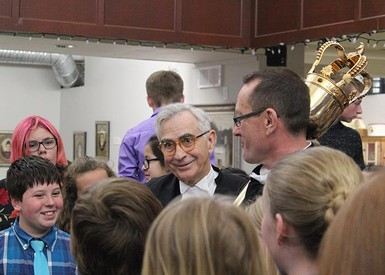 Speaker Robert Wanner,left, and Sergeant-at-Arms Brian Hodgson with the Alberta Mace, chat with R.I. Baker Middle School students.