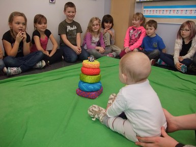 Grade 1 students at Noble Central School get acquainted with baby Maggie during the Roots of Empathy program.