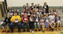 "Teacher McKenna Golding and her students hold a copy of their new book ""A Jumble of Words."""